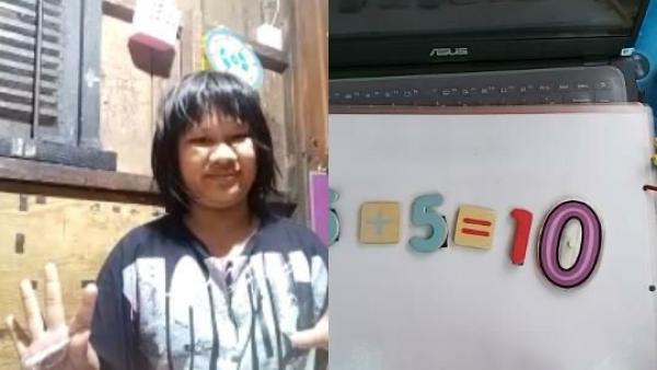 Ein kleines Mädchen mit einer Behinderung führt mit ihrer Erzieherin per Video eine Matheübung durch